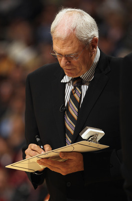 DENVER - NOVEMBER 11:  Head coach Phil Jackson of the Los Angeles Lakers draws up a play during a time out against the Denver Nuggets at Pepsi Center on November 11, 2010 in Denver, Colorado. NOTE TO USER: User expressly acknowledges and agrees that, by d