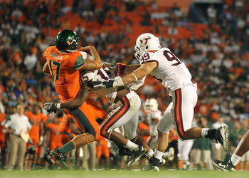 MIAMI - NOVEMBER 20:  Stephen Morris #17 of the Miami Hurricanes is sacked by Eddie Whitley #15 of the Virginia Tech Hokies at Sun Life Stadium on November 20, 2010 in Miami, Florida.  (Photo by Mike Ehrmann/Getty Images)