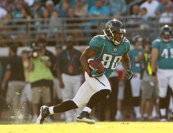 JACKSONVILLE, FL - NOVEMBER 14:  Mike Thomas #80 of the Jacksonville Jaguars runs after a catch during a game against the Houston Texans at EverBank Field on November 14, 2010 in Jacksonville, Florida.  (Photo by Mike Ehrmann/Getty Images)