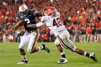 AUBURN, AL - NOVEMBER 13:  Quarterback Cameron Newton #2 of the Auburn Tigers breaks a tackle by Justin Houston #42 of the Georgia Bulldogs at Jordan-Hare Stadium on November 13, 2010 in Auburn, Alabama.  (Photo by Kevin C. Cox/Getty Images)
