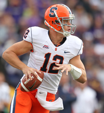 SEATTLE - SEPTEMBER 11:  Quarterback Ryan Nassib #12 of the Syracuse Orange rolls out to pass against the Washington Huskies on September 11, 2010 at Husky Stadium in Seattle, Washington. The Huskies defeated the Orange 41-20. (Photo by Otto Greule Jr/Get