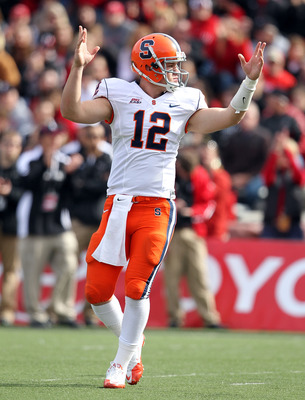 CINCINNATI - OCTOBER 30:  Ryan Nassib #12 of the Syracuse Orange celebrates a touchdown the Big East Conference game against the Cincinnati Bearcats at Nippert Stadium on October 30, 2010 in Cincinnati, Ohio.  (Photo by Andy Lyons/Getty Images)