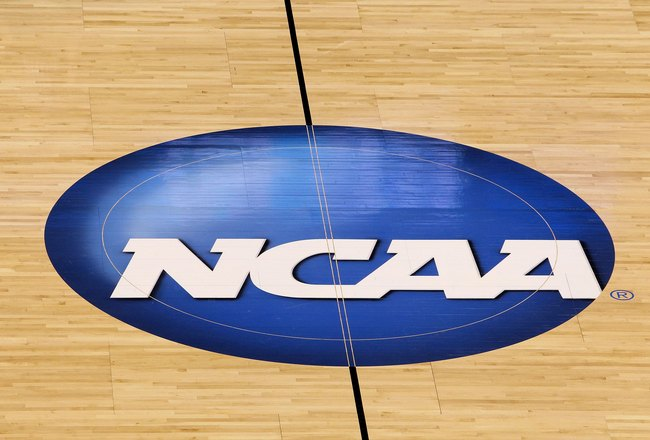 OKLAHOMA CITY - MARCH 20:  A detail of a NCAA logo  decal is seen at center court as the Kansas State Wildcats play against the Brigham Young Cougars during the second round of the 2010 NCAA men's basketball tournament at Ford Center on March 20, 2010 in