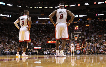 MIAMI - NOVEMBER 19:  Dwyane Wade #3 and LeBron James #6 of the Miami Heat look on during a game against the Charlotte Bobcats at American Airlines Arena on November 19, 2010 in Miami, Florida. NOTE TO USER: User expressly acknowledges and agrees that, by