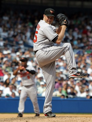 NEW YORK - AUGUST 15:  Erik Bedard #45 of the Baltimore Orioles pitches against the New York Yankees during their game at Yankee Stadium on August 15, 2007 in the Bronx borough of New York City.The Orioles defeated the Yankees 6-3 in ten innings.  (Photo