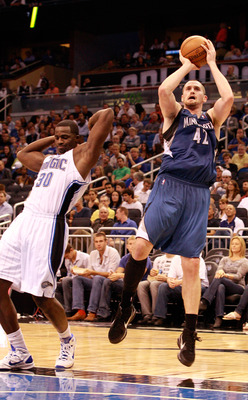 ORLANDO, FL - NOVEMBER 03:  Kevin Love #42 of the Minnesota Timberwolves attempts a shot over Brandon Bass #30 of the Orlando Magic during the game at Amway Arena on November 3, 2010 in Orlando, Florida.  NOTE TO USER: User expressly acknowledges and agre