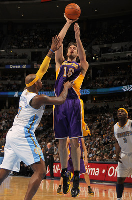 DENVER - NOVEMBER 11:  Pau Gasol #16 of the Los Angeles Lakers takes a shot over Al Harrington #7 of the Denver Nuggets at the Pepsi Center on November 11, 2010 in Denver, Colorado. The Nuggets defeated the Lakers 118-112.  NOTE TO USER: User expressly ac