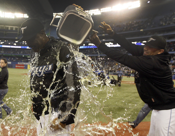 TORONTO, ON - SEPTEMBER 29:  Ricky Romero #24 (R) pours gatorade over Manager Cito Gaston after the Toronto Blue Jays defeated the the New York Yankees 8-4 during a MLB game at the Rogers Centre September 29, 2010 in Toronto, Ontario, Canada. (Photo by Ab