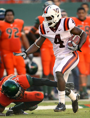 MIAMI - NOVEMBER 20:  David Wilson #4 of the Virginia Tech Hokies runs for a first down during a game against the Miami Hurricanes at Sun Life Stadium on November 20, 2010 in Miami, Florida.  (Photo by Mike Ehrmann/Getty Images)