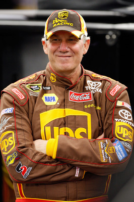 DAYTONA BEACH, FL - FEBRUARY 08: Dale Jarrett, driver of the #44 UPS Toyota, stands in the garage during practices for the Budweiser Shootout at Daytona International Speedway on February 8, 2008 in Daytona, Florida.  (Photo by John Harrelson/Getty Images