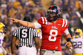 BATON ROUGE, LA - NOVEMBER 20:  Quarterback Jeremiah Masoli #8 of the Ole Miss Rebels reacts after scoring his second touchdown against the Louisiana State University Tigers at Tiger Stadium on November 20, 2010 in Baton Rouge, Louisiana.  (Photo by Kevin