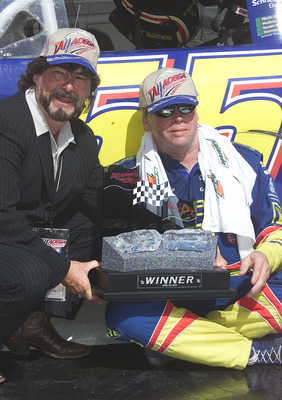 22 Apr 2001: Bobby Hamilton driving the #55 Square D Chevrolet receives the victors trophy from Country Music Legend Randy Owen after the NASCAR Winston Cup Talladega 500 at the Talladega Super Speedway, Talladega, Alabama.  <<Digital Image>> Mandatory Cr