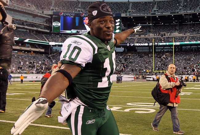 EAST RUTHERFORD, NJ - NOVEMBER 21: Santonio Holmes #10 of the New York Jets celebrates after defeating the Houston Texans on November 21, 2010 at the New Meadowlands Stadium in East Rutherford, New Jersey. The Jets defeated the Texans 30-27.  (Photo by Ji