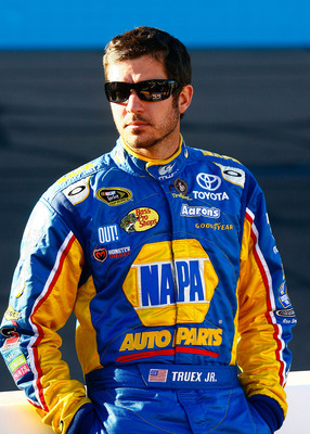 AVONDALE, AZ - NOVEMBER 12:  Martin Truex Jr., driver of the #56 NAPA Toyota, stands on pit road during qualifying for the NASCAR Sprint Cup Series Kobalt Tools 500 at Phoenix International Raceway on November 12, 2010 in Avondale, Arizona.  (Photo by Jas