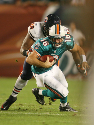 MIAMI - NOVEMBER 18: Quarterback Tyler Thigpen #16 of the Miami Dolphins is sacked by Henry Melton #69 of the Chicago Bears at Sun Life Stadium on November 18, 2010 in Miami, Florida.  (Photo by Marc Serota/Getty Images)
