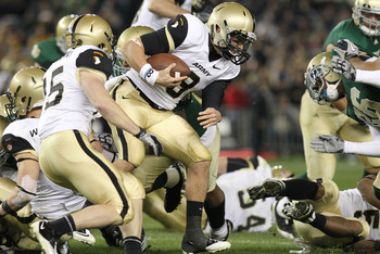 NEW YORK - NOVEMBER 20:  Trent Steelman #8 of the Army Black Knights is tackled against the Notre Dame Fighting Irish at Yankee Stadium on November 20, 2010 in the Bronx borough of New York City.  (Photo by Nick Laham/Getty Images)