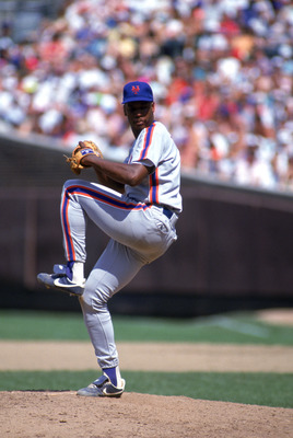 CHICAGO - 1990:  Dwight Gooden #16 of the New York Mets delivers a pitch during a game against the Chicago Cubs in 1990 at Wrigley field in Chicago, Illinois.  (Photo by Jonathan Daniel/Getty Images)