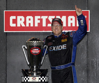 HOMESTEAD, FL - NOVEMBER 14:  Johnny Benson, driver of the #23 Exide Toyota, celebrates after winning the 2008 NASCAR Craftsman Truck Series Championship after racing during NASCAR Craftsman Truck Series Ford 200 at Homestead-Miami Speedway on November 14