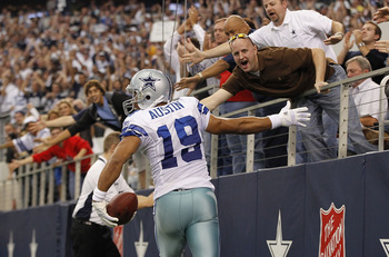 ARLINGTON, TX - NOVEMBER 21:  Miles Austin #19 of the Dallas Cowboys scores a third quarter touchdown on a 3 yard pass from Jon Kitna #3 and celebrates with the fans during the game at Dallas Stadium on November 21, 2010 in Arlington, Texas. The Cowboys d