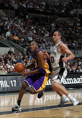 SAN ANTONIO - MARCH 24:  Guard Kobe Bryant #24 of the Los Angeles Lakers dribbles the ball past Manu Ginobili #20 of the San Antonio Spurs at AT&amp;T Center on March 24, 2010 in San Antonio, Texas.  NOTE TO USER: User expressly acknowledges and agrees that,
