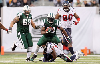 EAST RUTHERFORD, NJ - NOVEMBER 21:  LaDainian Tomlinson #21 of the New York Jets runs the ball against the Houston Texans on November 21, 2010 at the New Meadowlands Stadium in East Rutherford, New Jersey.  (Photo by Jim McIsaac/Getty Images)