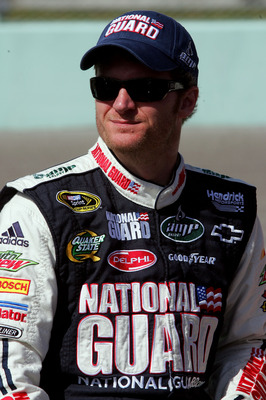 HOMESTEAD, FL - NOVEMBER 21:  Dale Earnhardt Jr., driver of the #88 National Guard/AMP Energy Chevrolet, stands on pit road prior to the NASCAR Sprint Cup Series Ford 400 at Homestead-Miami Speedway on November 21, 2010 in Homestead, Florida.  (Photo by J