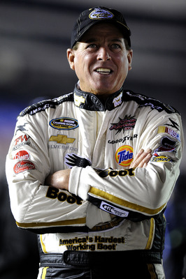 FORT WORTH, TX - NOVEMBER 04:  Ron Hornaday Jr., driver of the #33 Georgia Boot Chevrolet, stands on pit road during qualifying for the NASCAR Camping World Truck Series WinStar World Casino 350k at Texas Motor Speedway on November 4, 2010 in Fort Worth,