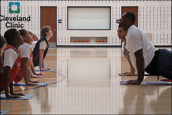 LBJ practicing yoga and really helping young kids.