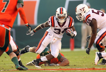 MIAMI - NOVEMBER 20:  Ryan Williams #34 of the Virginia Tech Hokies runs with the ball during a game against the Miami Hurricanes at Sun Life Stadium on November 20, 2010 in Miami, Florida.  (Photo by Mike Ehrmann/Getty Images)