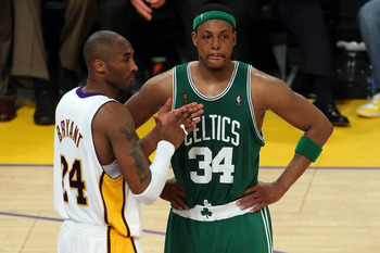 LOS ANGELES, CA - JUNE 15:  Kobe Bryant #24 of the Los Angeles Lakers claps in front of Paul Pierce #34 of the Boston Celtics in Game Five of the 2008 NBA Finals on June 15, 2008 at Staples Center in Los Angeles, California. NOTE TO USER: User expressly a