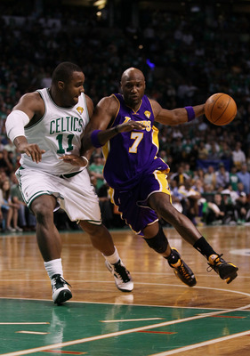 BOSTON - JUNE 13:  Lamar Odom #7 of the Los Angeles Lakers drives to the basket against Glen Davis #11 of the Boston Celtics during Game Five of the 2010 NBA Finals on June 13, 2010 at TD Garden in Boston, Massachusetts. NOTE TO USER: User expressly ackno