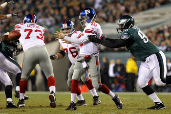 PHILADELPHIA - NOVEMBER 21:  Eli Manning #10 of the New York Giants gets rid of the ball as he is pressured by Antonio Dixon #90 of the Philadelphia Eagles at Lincoln Financial Field on November 21, 2010 in Philadelphia, Pennsylvania.  (Photo by Nick Laha