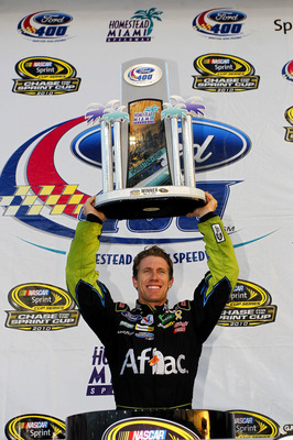 HOMESTEAD, FL - NOVEMBER 21:  Carl Edwards, driver of the #99 Aflac Ford, celebrates in Victory Lane after winning the NASCAR Sprint Cup Series Ford 400 at Homestead-Miami Speedway on November 21, 2010 in Homestead, Florida.  (Photo by Chris Trotman/Getty