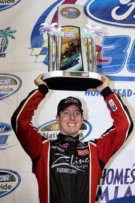 HOMESTEAD, FL - NOVEMBER 20:  Kyle Busch, driver of the #18 Z-Line Designs Toyota, celebrates in victory lane after winning the NASCAR Nationwide Series Ford 300 at Homestead-Miami Speedway on November 20, 2010 in Homestead, Florida.  (Photo by Jerry Mark