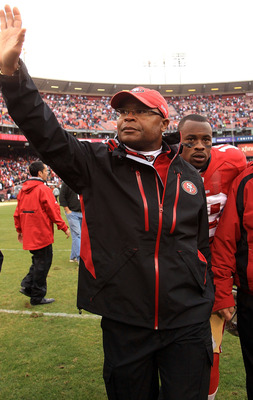 SAN FRANCISCO - OCTOBER 17:  Head coach Mike Singletary of the San Francisco 49ers waves to the crowd after they beat the Oakland Raiders at Candlestick Park on October 17, 2010 in San Francisco, California.  (Photo by Ezra Shaw/Getty Images)
