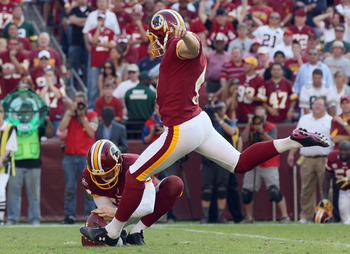 LANDOVER, MD - OCTOBER 10:  Washington Redskins kicker Graham Gano #4 kicks the game winning field goal in overtime against the Green Bay Packers at FedExField on October 10, 2010 in Landover, Maryland. The Redskins won the game 16-13.  (Photo by Win McNa