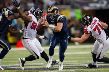 ST. LOUIS - NOVEMBER 21: Sam Bradford #8 of the St. Louis Rams scrambles against the Atlanta Falcons at the Edward Jones Dome on November 21, 2010 in St. Louis, Missouri.  The Falcons beat the Rams 34-17.  (Photo by Dilip Vishwanat/Getty Images)