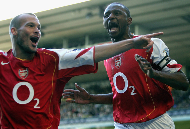 LONDON - NOVEMBER 13:  Patrick Vieira of Arsenal celebrates his goal with Freddie Ljungberg during the Barclays Premiership match between Tottenham Hotspur and Arsenal at White Hart Lane on November 13, 2004 in London, England.  (Photo by Ian Walton/Getty