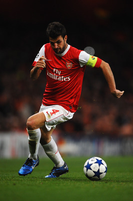 LONDON, ENGLAND - OCTOBER 19:  Captain Cesc Fabregas of Arsenal in action during the UEFA Champions League Group H match between Arsenal and FC Shakhtar Donetsk at the Emirates Stadium on October 19, 2010 in London, England.  (Photo by Laurence Griffiths/