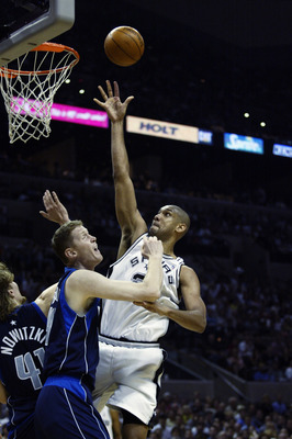 SAN ANTONIO - MAY 19:  Tim Duncan #21 of the San Antonio Spurs shoots over Shawn Bradley #45 and Dirk Nowitzki #41 of the Dallas Mavericks in Game one of the Western Conference Finals during the 2003 NBA Playoffs at SBC Center on May 19, 2003 in San Anton