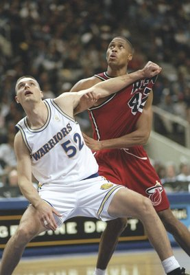 26 Nov 1996: Center Todd Fuller of the Golden State Warriors and P.J. Brown of the Miami Heat fight for position during a game at the San Jose Arena in San Jose, California. The Heat won the game 107-88.