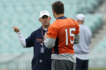 LONDON, ENGLAND - OCTOBER 29:  Head coach of the Denver Broncos Josh McDaniels talks with Tim Tebow #15  during a team training session at The Brit Oval on October 29, 2010 in London, England. The Denver Broncos will play the San Francisco 49ers at Wemble