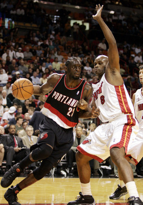 MIAMI - NOVEMBER 18:  Forward Darius Miles #23 of the Portland Trailblazers drives against forward Antoine Walker #8 of the Miami Heat on November 23, 2005 at the American Airlines Arena in Miami, Florida. NOTE TO USER: User expressly acknowledges and agr