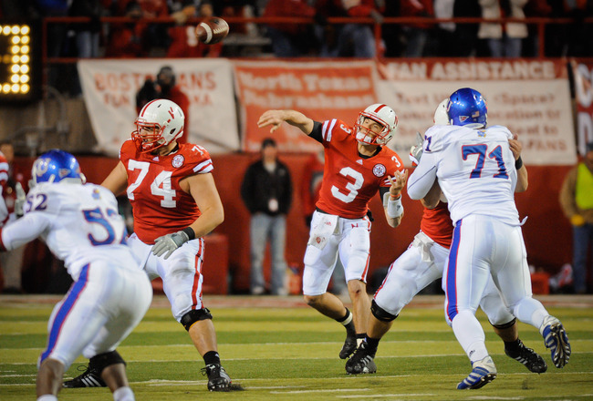 LINCOLN, NE - NOVEMBER 13: Taylor Martinez #3 of the Nebraska Cornhuskers throws the ball downfield against the Kansas Jawhawks during second half action of their game at Memorial Stadium on November 13, 2010 in Lincoln, Nebraska. Nebraska Defeated Kansas