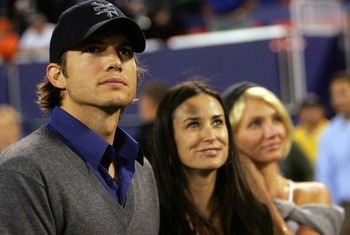 EAST RUTHERFORD, NJ - SEPTEMBER 30:  (L-R) Actor Ashton Kutcher, wife actress Demi Moore and actress Cameron Diaz stand on the sidelines before the start of the game between the Philadelphia Eagles and the New York Giants at Giants Stadium on September 30