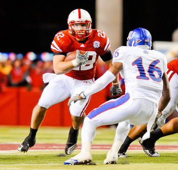 LINCOLN, NE - NOVEMBER 13: Rex Burkhead #22 of the Nebraska Cornhuskers looks to avoid Chris Harris #16 of the Kansas Jayhawks during their game at Memorial Stadium on November 13, 2010 in Lincoln, Nebraska. Nebraska Defeated Kansas 20-3. (Photo by Eric F