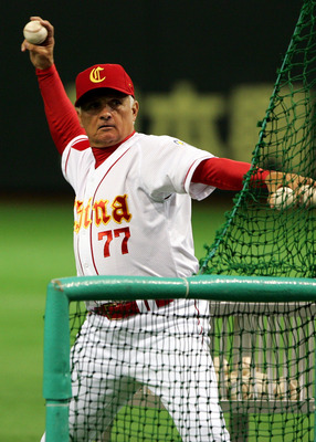 TOKYO - MARCH 07:  Manager Terry Collins #77 of Team China throws to players warming-up prior to Game 3 of the 2009 World Baseball Classic Pool A match between China and Chinese Taipei at Tokyo Dome on March 7, 2009 in Tokyo, Japan.  (Photo by Koji Watana