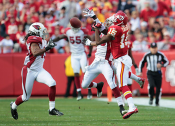 KANSAS CITY, MO - NOVEMBER 21:  A.J. Jefferson #20 of the Arizona Cardinals breaks up a pass intended for Verran Tucker #15 of the Kansas City Chiefs at Arrowhead Stadium on November 21, 2010 in Kansas City, Missouri.  (Photo by Jamie Squire/Getty Images)
