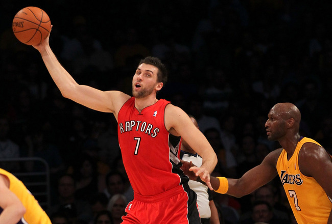 LOS ANGELES, CA - NOVEMBER 05:  Andrea Bargnani #1 of the Toronto Raptors controls the ball against Lamar Odom #7 of the Los Angeles Lakers at Staples Center on November 5, 2010 in Los Angeles, California.   NOTE TO USER: User expressly acknowledges and a