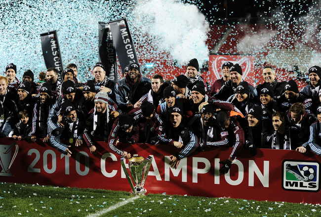 TORONTO, ON - NOVEMBER 21:  Members of the Colorado Rapids celebrate with the Philip F. Anschutz Trophy in honor of their 2-1 overtime victory over FC Dallas following the 2010 MLS Cup match at BMO Field on November 21, 2010 in Toronto, Canada.  (Photo by